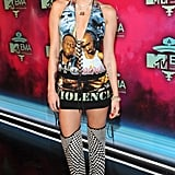 Miley Cyrus rocked a risqué rap-inspired look at the MTV EMAs in Amsterdam.