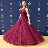 Wearing a burgundy Zac Posen dress to the 2018 Emmys.