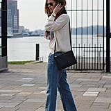 How to achieve the laid-back but sophisticated vibe is all in this look – a pair of sleek pumps balanced out a staple sweater and 'laxed denim. Source: Lookbook.nu