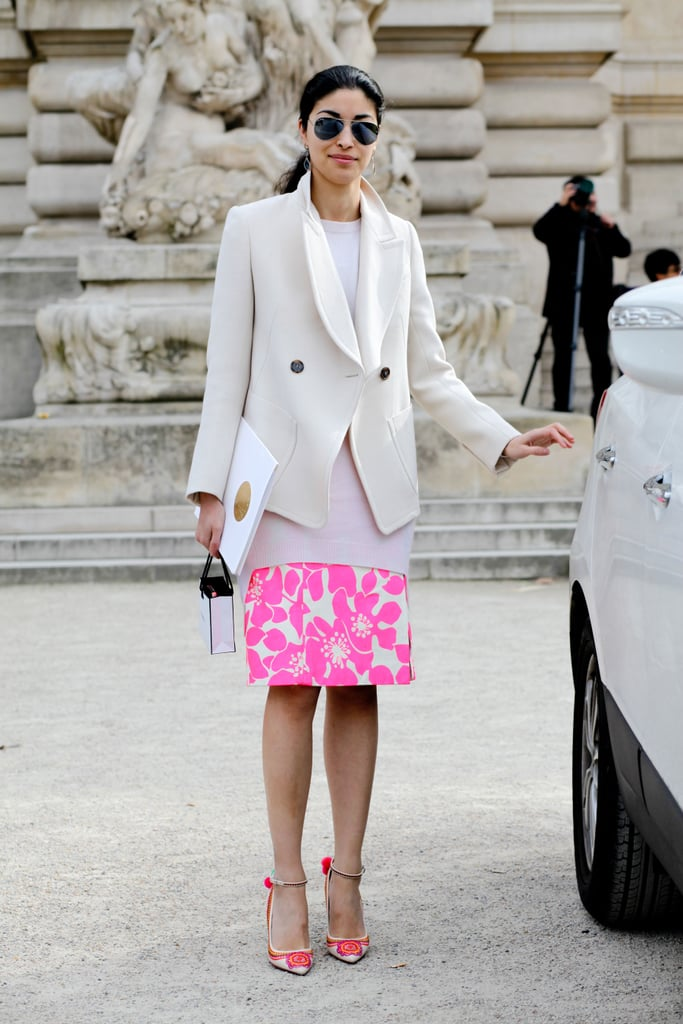 Caroline Issa gave a floral-print skirt a cooler finish with a sleek white topper and aviators.