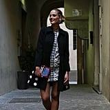 We played on the notion of the schoolgirl look that filled the Fall runways with the polka-dot Moschino coat ($2,349) paired with a cheeky Olympia Le-Tan book clutch ($1,711).