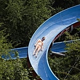 In Prague, a girl took to a waterslide to beat the heat.