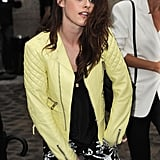 Kristen Stewart stepped out in a neon leather jacket for Balenciaga's Paris Fashion Week runway presentation.