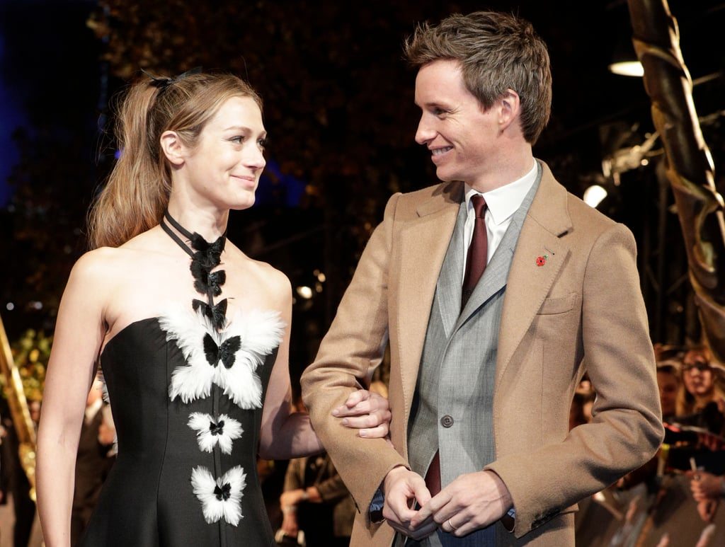 "If you're on the market for some real life magic, look no further than Eddie Redmayne and his wife Hannah Bagshawe in a room together, it's electric. The Fantastic Beasts: The Crimes of Grindelwald actor and the PR executive originally met while Eddie was studying at Eton. ""Hannah was at a girls' school near Eton and they invited some of our guys over to do a fashion show for charity,"" Eddie explained, adding ""I saw Hannah across the room at a party afterwards and she was very beautiful and very funny and she loves the arts and theatre just as I do, so we became friends."" The pair went on to tie the knot in December 2014 and are now the proud parents of daughter Iris Mary and son Luke Richard. Keep reading for a look at their loving embraces over the years.      Related:                                                                                                                                Eddie Redmayne on Playing Rugby With Prince William: ""I Always Felt a Bit Sorry For Him"""