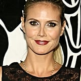 Moody lips, black eyeliner, and a tight ponytail made for a sexy look on Heidi Klum.