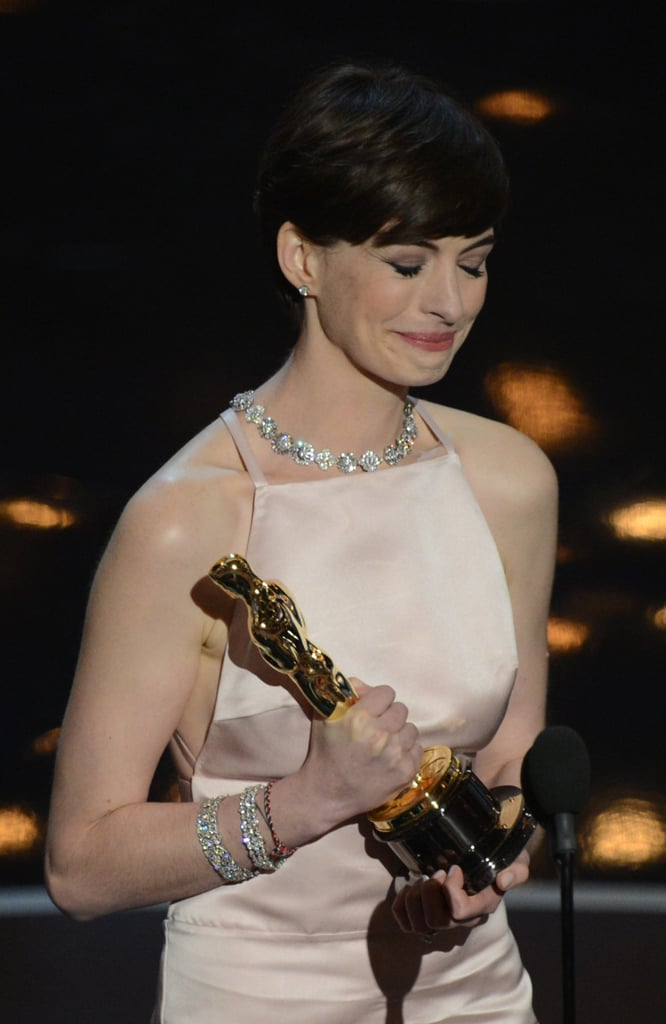 Anne Hathaway on stage at the Oscars 2013 accepting her award for best supporting actress.