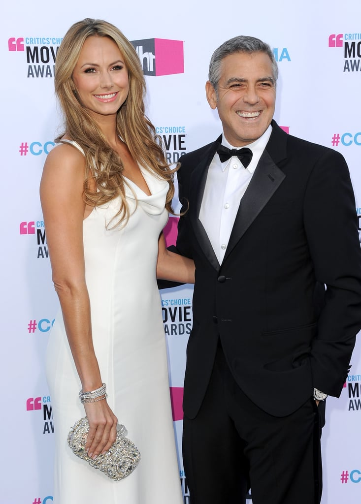 George Clooney couldn't stop smiling with the help of Stacy Keibler in a white dress.
