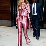Gigi worked metallic pink like a pro, finishing the look with Aquazzura platforms.
