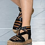 A cool girl's espadrille with a buckle front ankle.