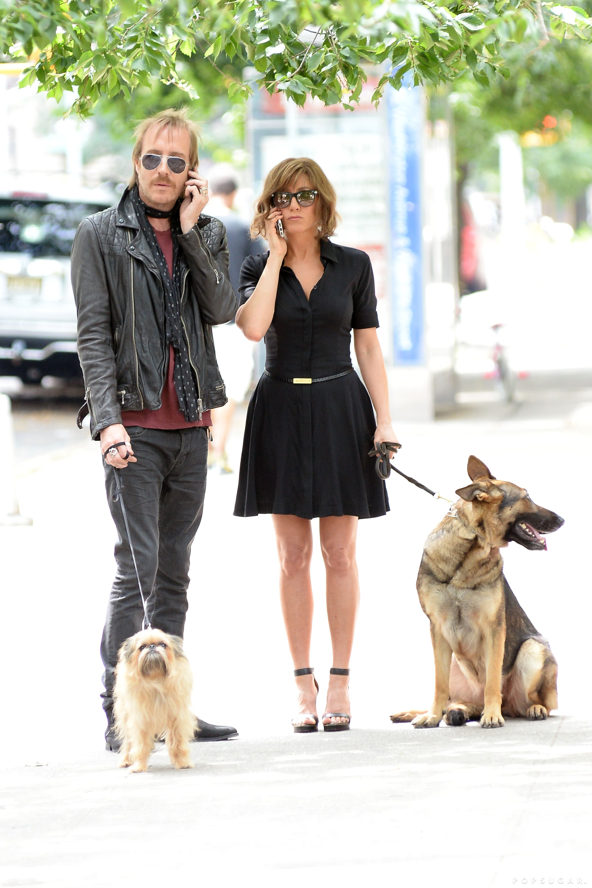 Jennifer Aniston and Rhys Ifans fielded phone calls and handled dogs on set in NYC on July 31.