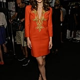 Katharine McPhee went for gold embellishment on a brightly hued tunic at Michael Kors.
