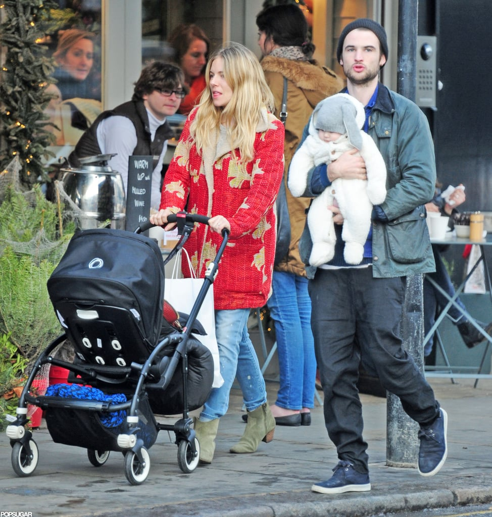 Sienna Miller and her fiancé, Tom Sturridge, went for a walk in Notting Hill yesterday with their daughter, Marlowe Sturridge. It's the end of a big year for Sienna and Tom. In addition to getting engaged, Sienna and Tom welcomed Marlowe into the world on July 7.  Sienna got an early holiday present last week when her HBO project, The Girl, got love from the Hollywood Foreign Press Association in the form of multiple Golden Globe nominations. Sienna's up for a Globe in the best performance by an actress in a miniseries or motion picture made for television category, and her leading man, Toby Jones, is in contention for the corresponding honor. The Girl could also take home best miniseries or motion picture made for television if it beats out Game Change, Hatfields & McCoys, The Hour, and Political Animals — check out the full list of Golden Globe nominees. Hopefully we'll see Tom and Sienna sharing the red carpet when the show takes place Sunday Jan. 13, 2013. Tom's biggest 2012 project, On the Road, did not get any recognition despite serious promotional efforts by himself and his costars.
