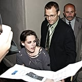 In usual Kristen manner, she changed from her fitted dress to a loose, torn tee.