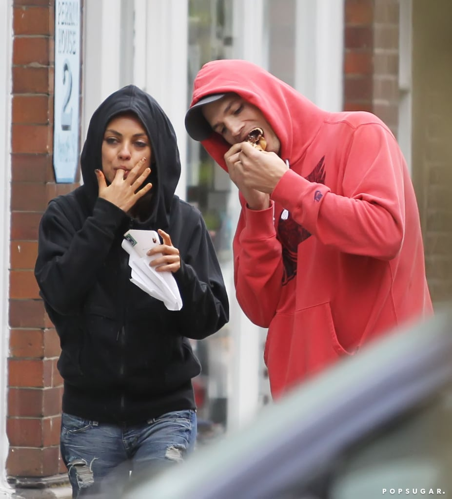 Mila Kunis and Ashton Kutcher devoured their crepes on the streets of London.