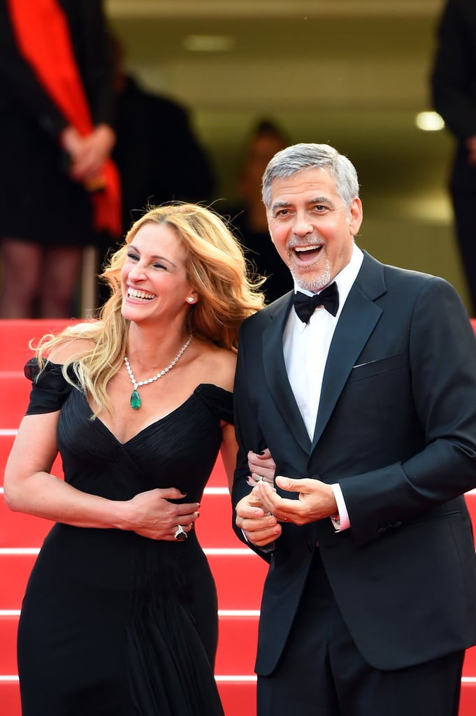 "Julia Roberts and George Clooney have been as thick as thieves since starring in Ocean's Eleven together in 2001. (Sorry, we couldn't resist.) Since then, the two friends have hit many red carpets, appeared in three other movies together, and even caught a ride in Gwen Stefani's Carpool Karaoke — but no matter the occasion, Julia and George always seem to be absolutely losing their sh*t and cracking up whenever they're reunited. What's more, Julia is a fan of George's wife, Amal Clooney, with whom he welcomed twins in 2017. ""George doesn't need my approval,"" Julia told People, ""but I am quite enamored of her."" Ahead, see the sweetest pictures to come out of this high-profile friendship."
