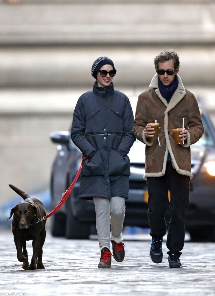 Anne Hathaway and Adam Shulman walked their dog in NYC.