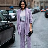 Tiffany Hsu makes a masculine pantsuit feminine by opting for a lavender suit.