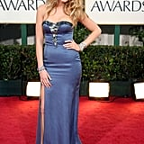 Wearing a Nina Ricci gown and Fred Leighton jewels to the 2009 Golden Globe Awards.