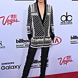 Kendall was wearing a silk and velvet embellished blazer with thigh-high boots, all of which will be available this Fall.