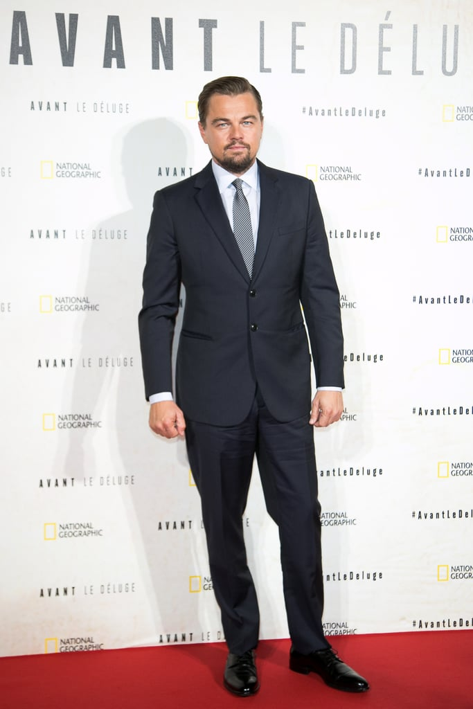 """Following his date with girlfriend Nina Agdal in LA, Leonardo DiCaprio jetted off to France for the premiere of Before the Flood on Monday. The actor, who turns 42 next month, looked strikingly handsome as he posed for photos on the red carpet before making his way inside the Théâtre du Châtelet. While on stage, Leo — who's featured in the documentary along with Barack Obama and Pope Francis — gave an impassioned speech about climate change, a cause incredibly close to his heart.   Leo's latest appearance comes amid reports that he's been urged to give up his title as UN messenger of peace with a focus on climate change because of his connection to individuals involved in a Malaysian corruption scandal. While Leo has yet to address the issue, a press conference was held in London last week, where the Bruno Manser Fonds, a Switzerland-based rainforest charity, gave Leo the ultimatum of either stepping down from his role or renouncing his connections to the """"politically exposed persons"""" and returning corrupt money he allegedly received."""