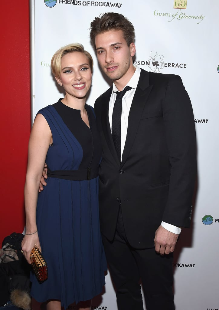"""Scarlett Johansson brought a very special date — her twin brother, Hunter Johansson — to the second annual Champions of Rockaway Hurricane Sandy Benefit in NYC on Tuesday. The actress, who gave birth two months ago, left her fiancé, Romain Dauriac, at home and instead chose to make the charity event a family affair. While at the event, Scarlett explained her and Hunter's connection to the Big Apple: """"Hunter and I were here in New York . . . seeing the city shaken once more [by Hurricane Sandy]; it was totally, totally shocking for the people that were living here. Two years later, people are feeling huge effects of this devastating loss."""" Scarlett has slowly been easing back into public life ever since she gave birth to daughter Rose back in September. She made her first postbaby appearance earlier this month when she hosted a special screening for The Theory of Everything for her former costar Eddie Redmayne. By the time next Spring rolls around, she'll be back to full press duties, as she will be promoting her latest superhero flick, Avengers: Age of Ultron, which hits theaters on May 1. In the meantime, check out more celebrities with their siblings!"""
