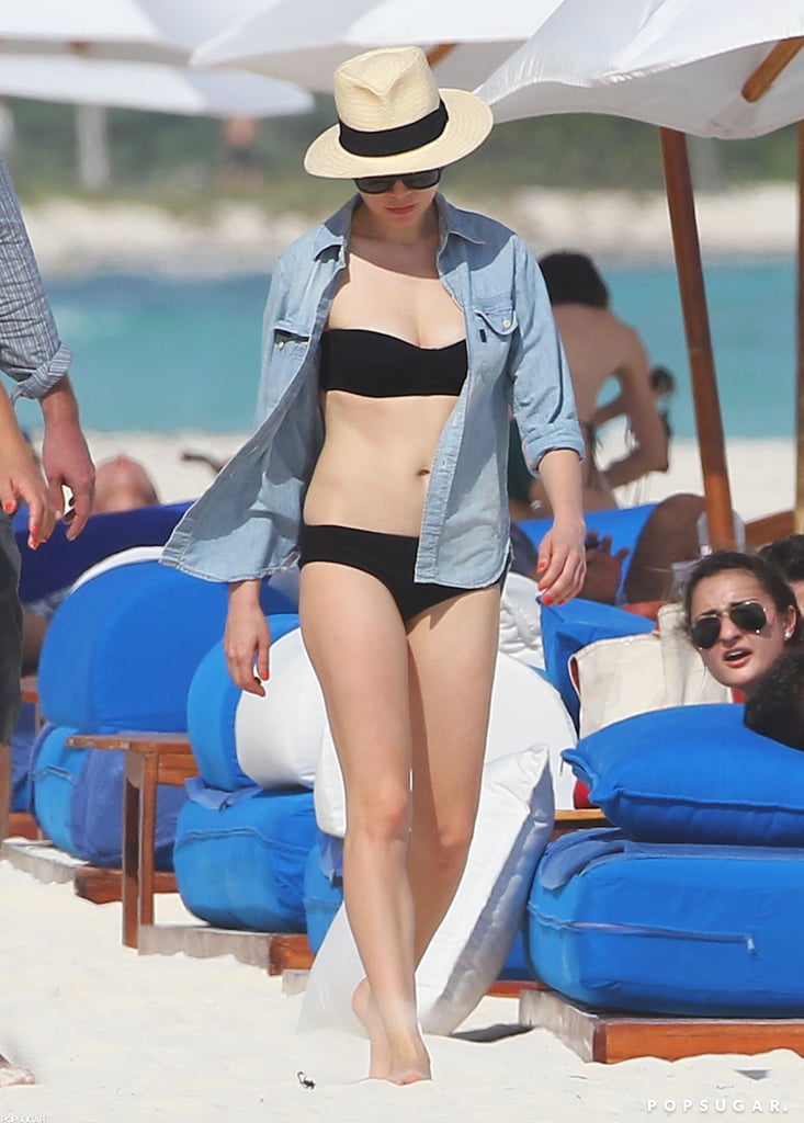 Michelle Williams covered up with a panama hat.