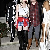 Emma Roberts nodded to her aunt Julia in a Pretty Woman outfit alongside her boyfriend Evan Peter at a Friday party in LA.
