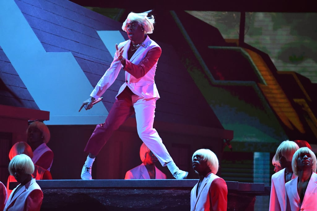 "We're just going to say it: Tyler, the Creator had one of the most captivating performances at the Grammys. On Sunday, the 28-year-old rapper took the stage to perform his hits ""Earthquake"" and ""New Magic Wand"" from his album Igor, which was nominated for best rap album. Donning his signature blonde wig with a colorblock suit, he locked us in with his excited dancing and  stageing effects. In fact, he gave so much energy, he had to take a puff of his inhaler. (The man has to breathe, right?) Look ahead to watch a clip of his performance, then view more photos from his set!      Related:                                                                                                           Billie Eilish, Lizzo, Lil Nas X, and Everyone Else Who Took Home a Grammy This Year"