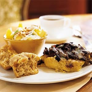 For best presentation use yellow grits in this grits casserole with mushrooms, prosciutto, and provolone. The trio of flavors will make a perfectly homey meal for mom.