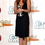 "In 2005, Jen proudly displayed her ""Female Star of the Year"" ShoWest Award donning a sleek black wrap dress and ankle-wrap sandals in Las Vegas."