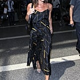 Victoria wearing a matchstick-print pleated LBD in July 2016.