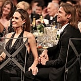Angelina held Brad's leg during the show.