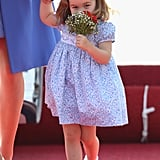 Princess Charlotte literally stopped to smell the flowers while visiting Germany with her parents in July.