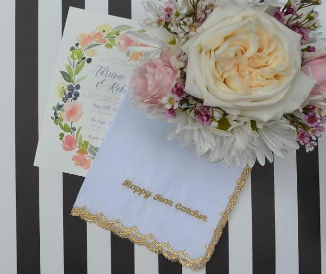 Have handkerchiefs embroidered with gold thread for a delicate favour.