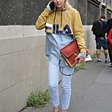 Change up skinny jeans with a hoodie and heels