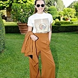 Mix up a sophisticated pair of high-waist pants with your favorite well-worn T-shirt and a pair of shades.