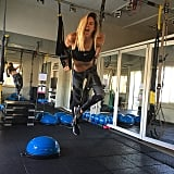 What's not to love about this Bar Refaeli photo? Between her wild printed pants, silly face, and hold on the TRX trainer, we're ready to schedule a workout date with this seriously strong supermodel.