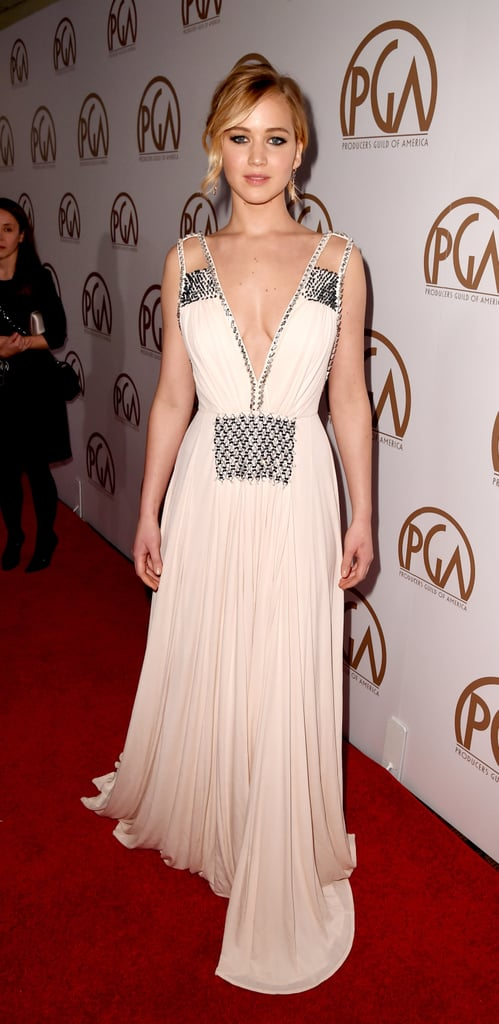 The actress dazzled in a plunging Prada gown with shimmering embellishments while at the 2015 Producers Guild Awards.