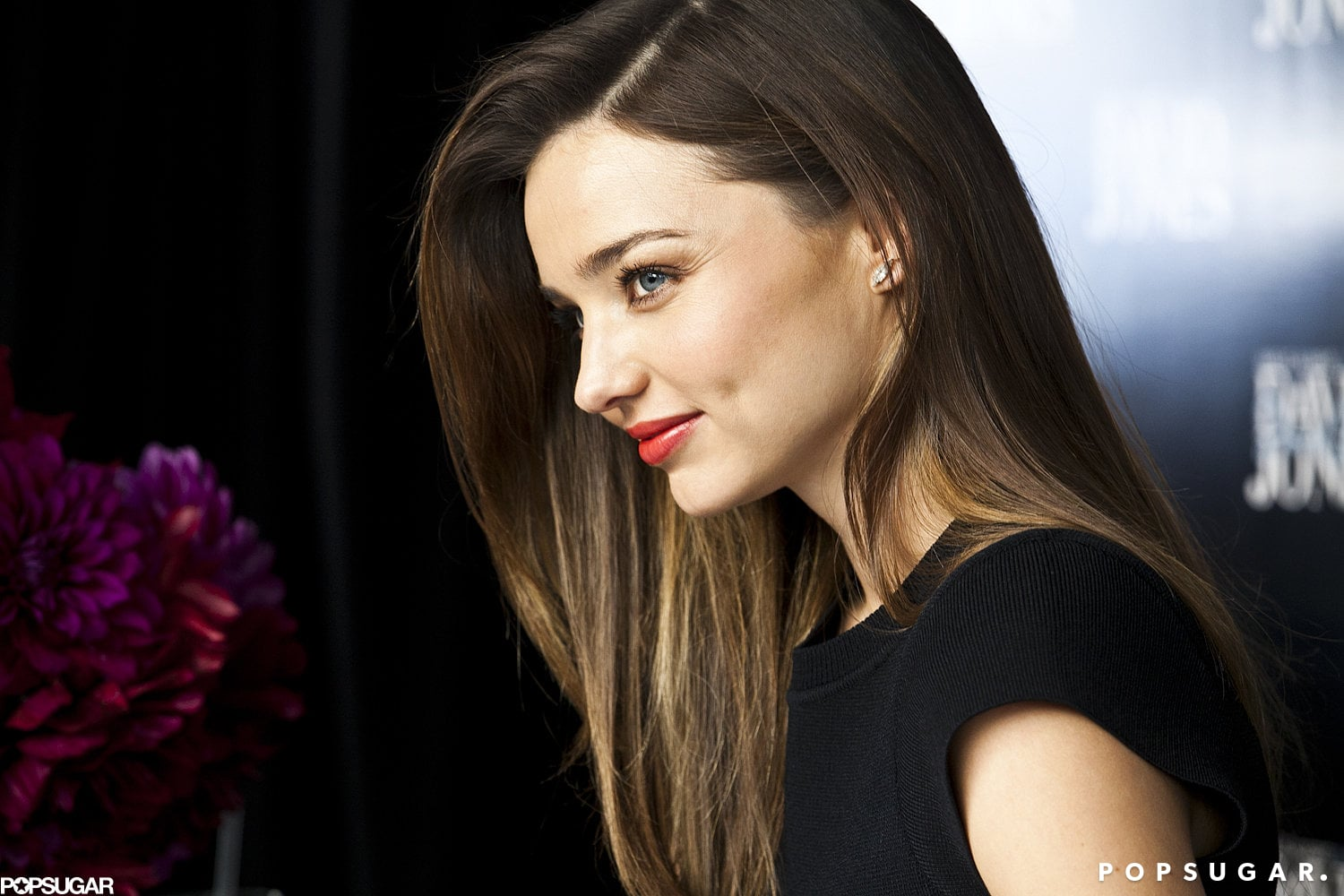 miranda kerr wore her hair down and finished off her look