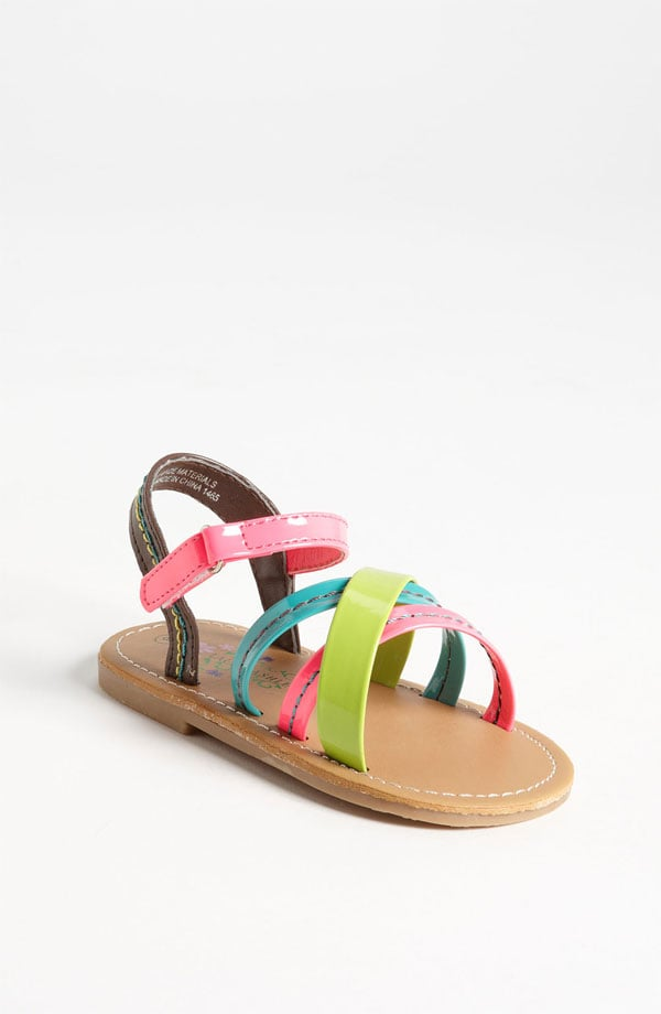 The genius behind Laura Ashley's superstrappy neon sandals ($30) is that they're full of color but will still go with most anything in her closet.