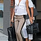 In a breezy sleeveless blouse and tuxedo-striped pants, Miranda's daywear is cooler than most; it all comes down to proportions and sophisticated details, like her posh pointed-toe Manolos.