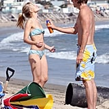 Dax helped Kristen apply sunscreen during an August 2008 Malibu beach day.