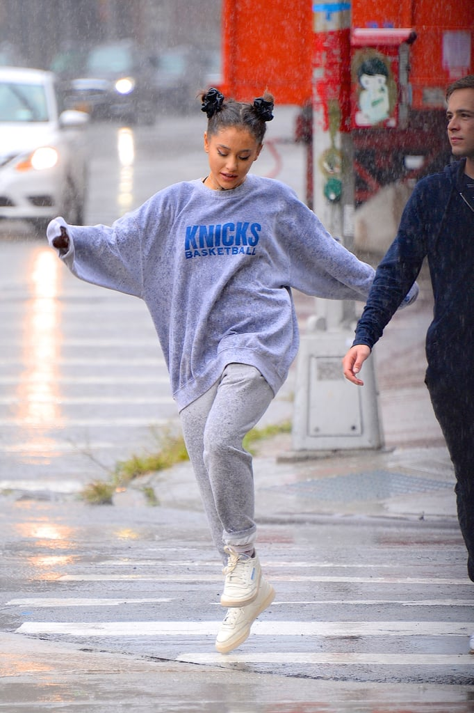 "Ariana Grande is surrounding herself with close friends. After skipping the Emmys on Monday night, the ""God Is a Woman"" singer was spotted braving the rain in NYC on Tuesday afternoon. Ariana appeared to be in good spirits as she walked around the city, sipped on coffee, and danced through the storm.  While the singer was originally scheduled to attend the Emmys alongside her fiancé Pete Davidson, she opted not to go last minute. ""Given the events of the past couple of years, Ariana is going to take some much needed time to heal and mend,"" her team said in a statement to E! News. ""She will be staying close to home and using this period to spend time with her loved ones and work on new music without deadline. She thanks her fans for their understanding."" The award show came 10 days after Ariana's ex-boyfriend Mac Miller was found dead in his home after an apparent overdose. On Sept. 14, Ariana spoke out for the first time since his death by sharing a personal video of Mac on Instagram. ""I can't believe you aren't here anymore. I really can't wrap my head around it,"" she wrote. ""I'm so sorry I couldn't fix or take your pain away. I really wanted to."""