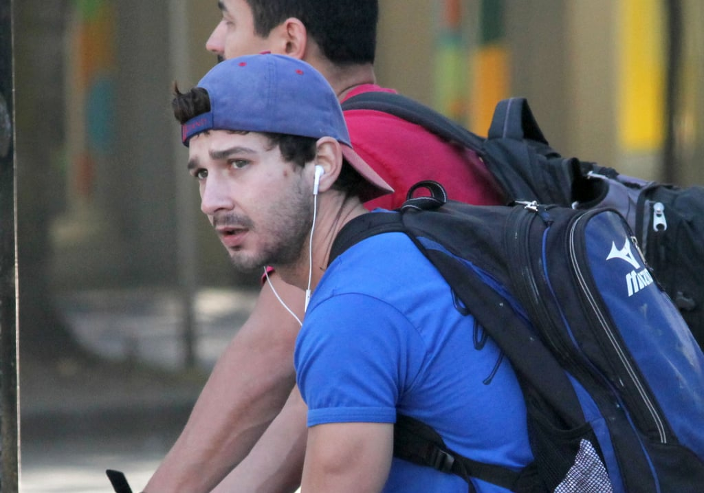 Shia LaBeouf wore a blue hat and shirt.