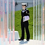 A member of the Royal Navy held a flag during the Olympic team welcoming ceremony at the Olympic Park.