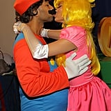 The couple looked too cute in their Mario and Princess Peach costumes during Chrissy's birthday party in November 2013.