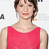 Mia Wasikowska's wispy, crown braid and pink lip complemented her dress perfectly at the Tracks premiere.