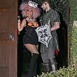 Christina Aguilera showed off knee-high boots, an orange-tinged bustier, and a vibrant pink wig — it was all part of her zany Halloween costume.