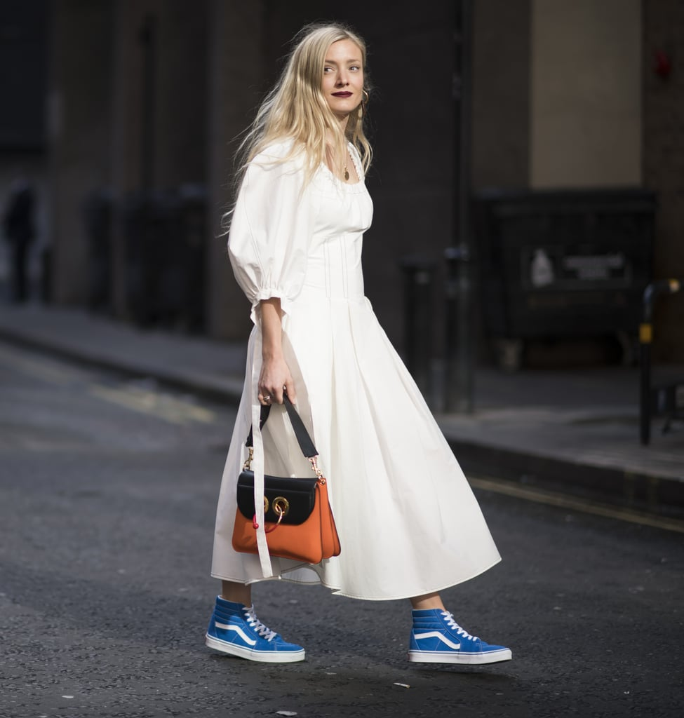 With a Simple, Poufy-Sleeved Dress and Handbag