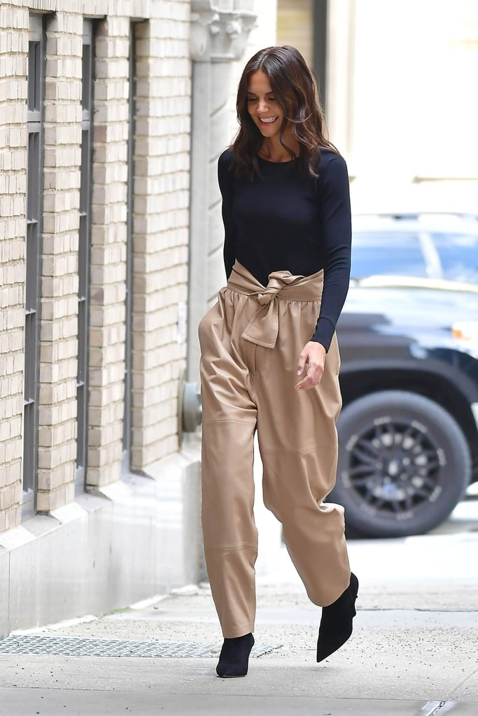 In high-waisted tie-front pants, Katie instantly elevates the trouser and tee formula.